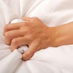 hand-grab-sheet-bed-orgasm-thumb